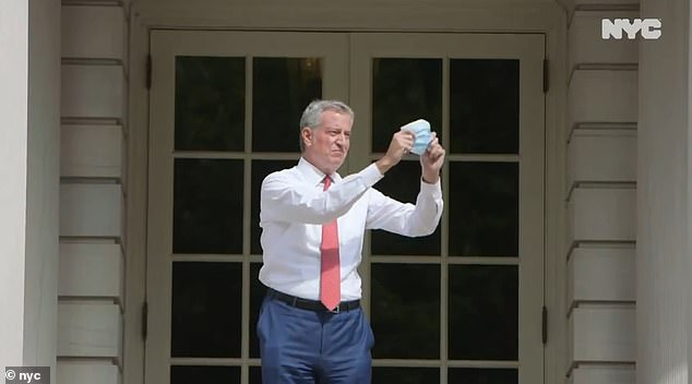 New York Mayor Bill de Blasio is branded a clown for video mocking Trump