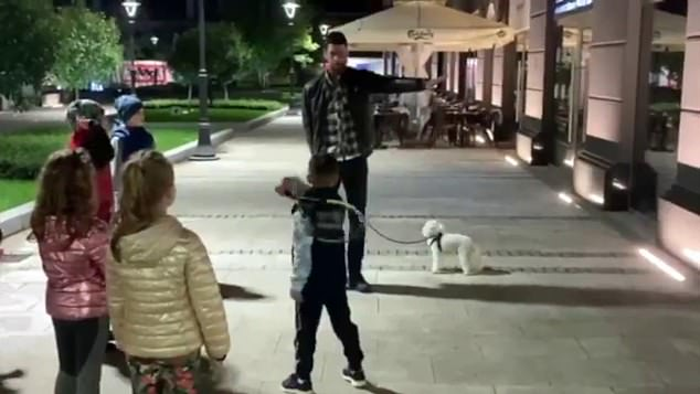 Novak Djokovic hailed as he gives tennis tips to Belgrade kids… but should he have a face mask on?