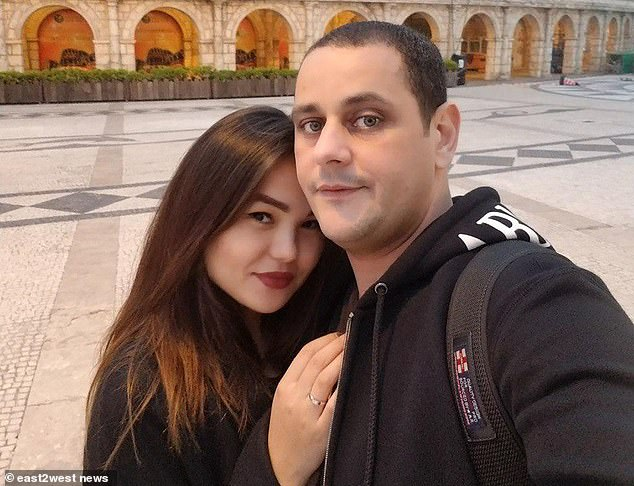 Pilot's wife screamed 'he killed my child' as she carried its lifeless body through Kazakh hotel