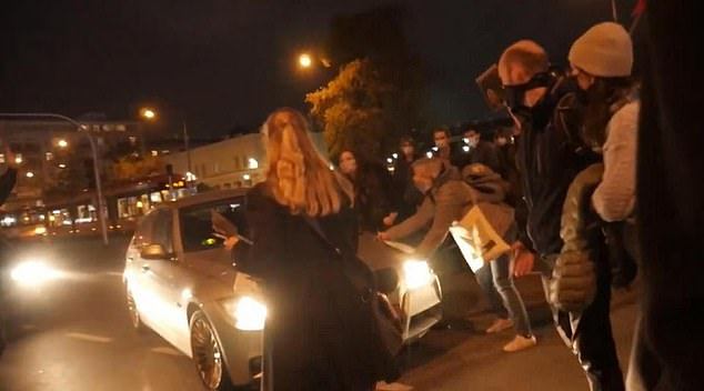 Polish spy drives through abortion law protesters as fury over restrictions grows