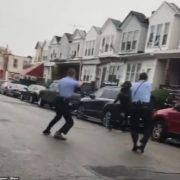 Protests erupt in Philadelphia after police shot and killed a knife-wielding black man, 27