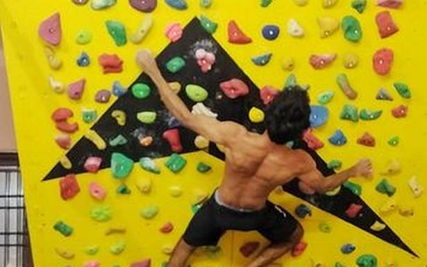 Race to the ceiling with a rock-climbing wall in your home
