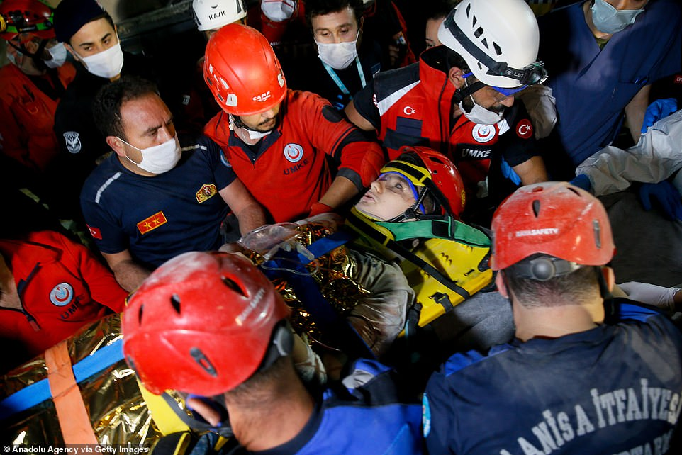 Rescuers search into the night for survivors after powerful 7.0-magnitude earthquake in Turkey