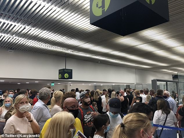 Rhodes to HELL: 'Fights break out' as 'thousands' of tourists are crushed together at Greek airport