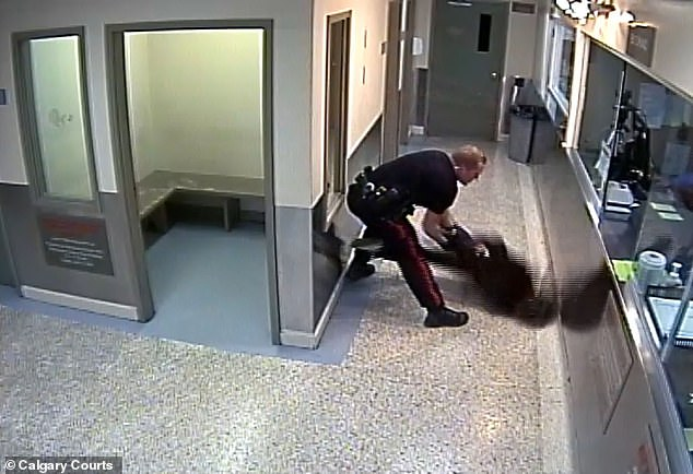 Surveillance footage shows Calgary cop slamming a handcuffed black woman face-first to the floor