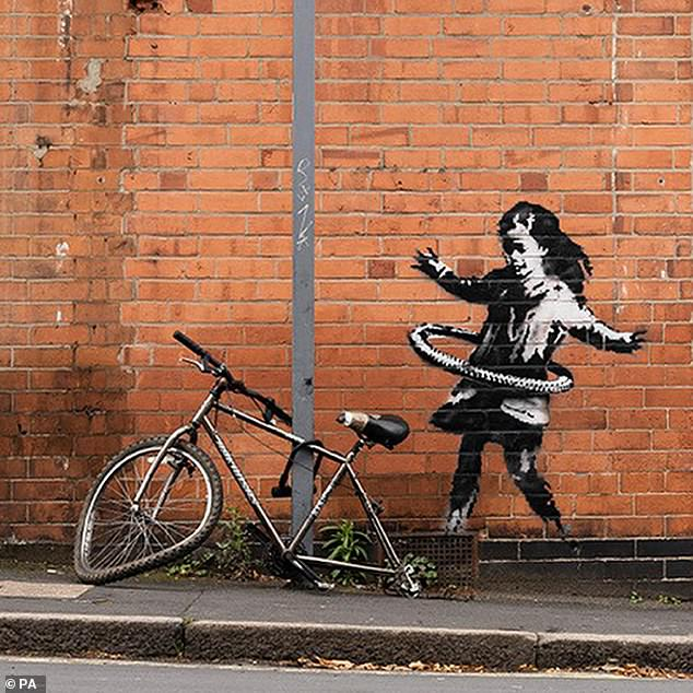 Take it to the Banksy! Banksy unveils new artwork on wall of Nottingham beauty salon