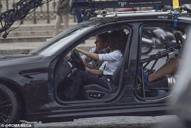 Tom Cruise and Hayley Atwell race across Rome in a car before on set of Mission Impossible 7