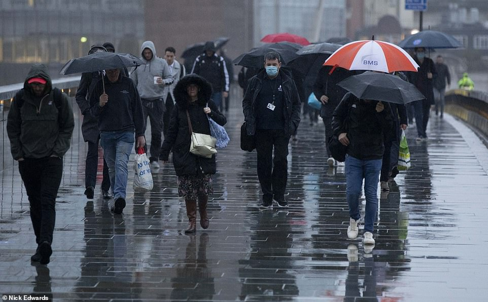 UK weather: Commuters endure miserable journey to work as Storm Barbara hits