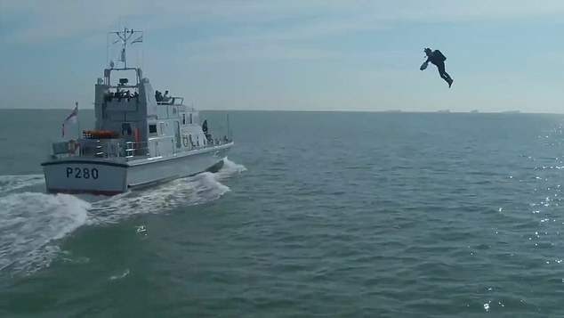 Video shows Royal Navy using flying Iron Man-style jet suits as they practise storming enemy ships