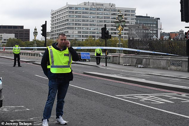Westminster Bridge is closed as armed police deal with 'security alert' at St Thomas's Hospital