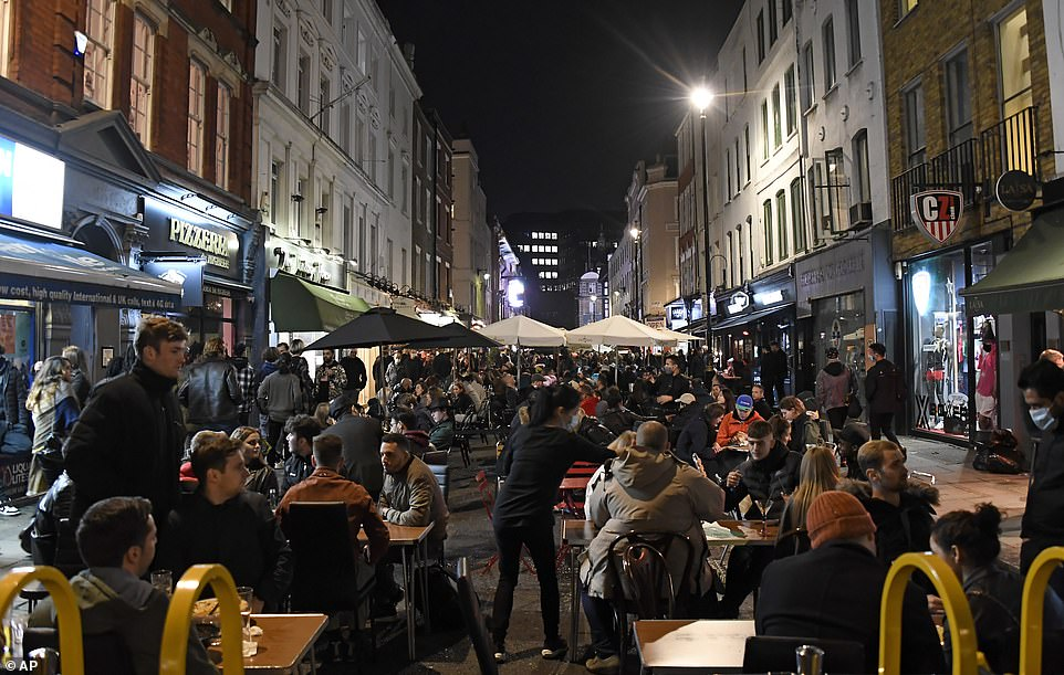 Drinkers and diners in Soho, central London enjoyed a final Saturday night out with friends ahead of England's shutdown