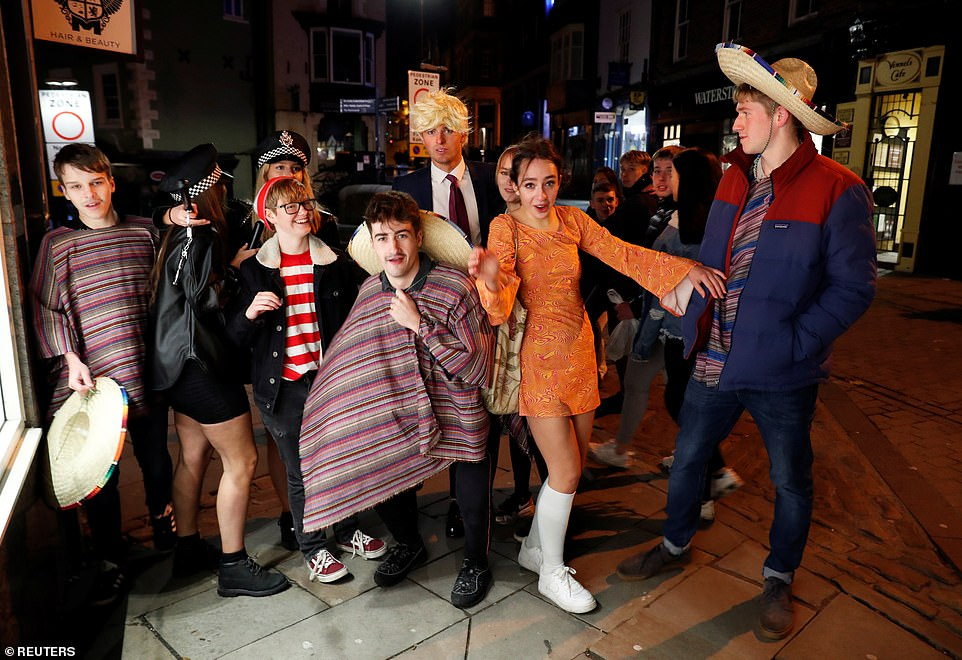 Revellers head out into Durham in fancy dress on the last Saturday before England's new month-long shutdown