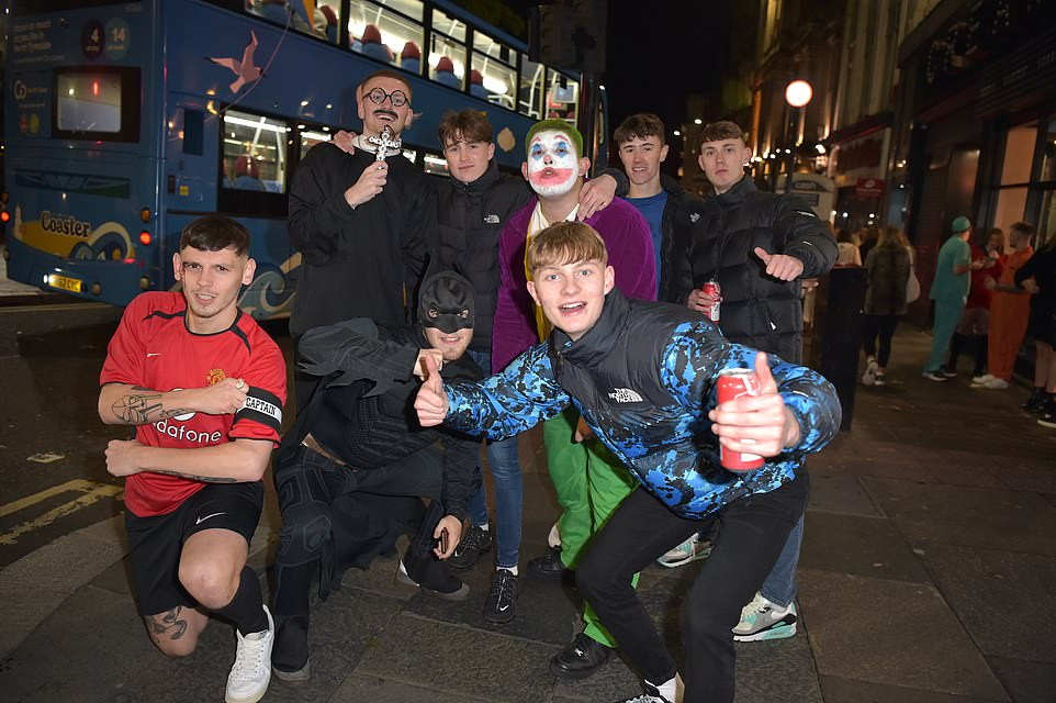 Revellers dressed up as Batman and the Joker in Newcastle on Halloween ahead of England's new shutdown