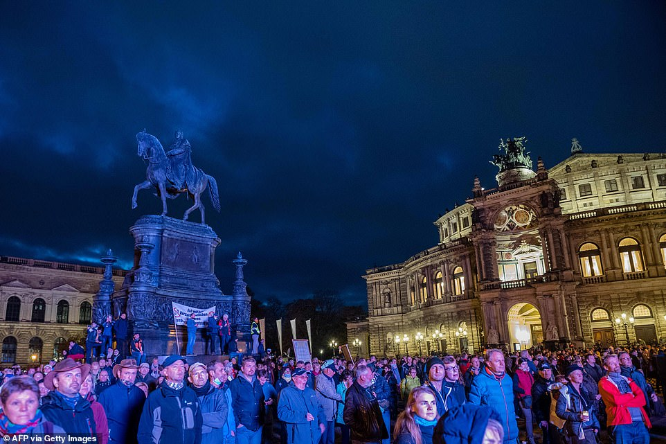 Although not as ill-tempered as elsewhere, there were also protests in the German city of Dresden organised by anti-lockdown group Querdenken 571