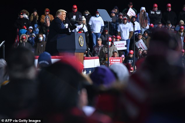 Trump speaks during a rally at Williamsport Regional Airport in Montoursville where hebragged about an executive order he signed to protect fracking - a huge industry in Pennsylvania