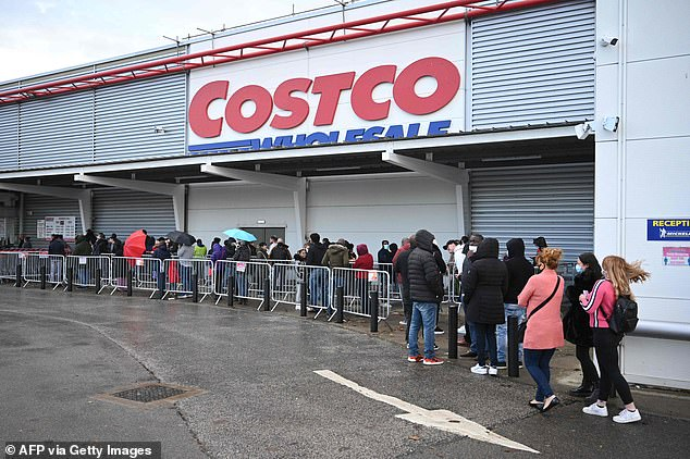 Shoppers queue outside a Costco wholesale store in Leeds as the country prepares to enter a second national lockdown
