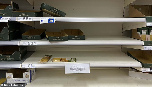 Shelves of pastas are emptied as shoppers prepare to hunker down at home for the next month