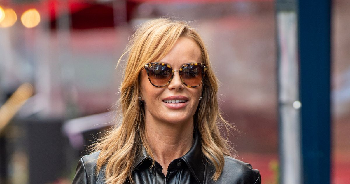 Amanda Holden shows off her age-defying body in skintight leather dress