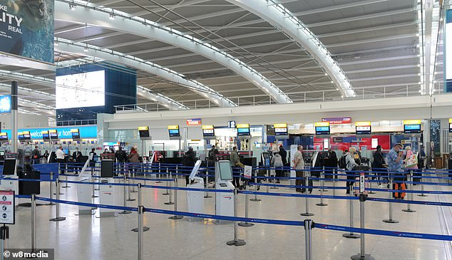 The Foreign Office website says from Thursday there will be 'no exemption for staying away from home on holiday' (pictured, Heathrow yesterday)