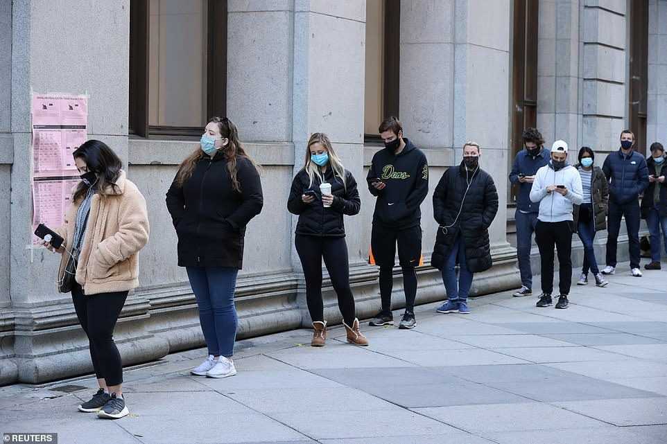 PHILADELPHIA, PENNSYLVANIA: Voters wearing masks lined up down the block at a polling station in the city