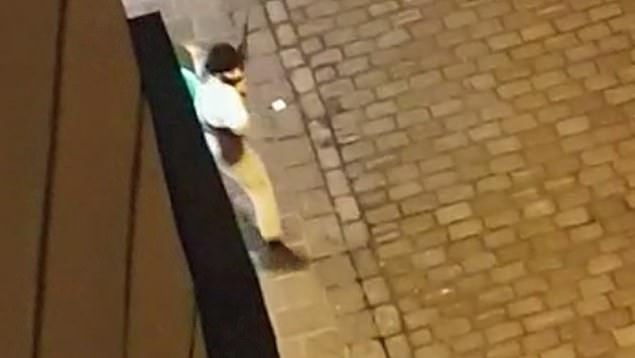 A man carrying what looks like an AK-47 rifle and believed to be the gunman who carried out the rampage in Vienna on Monday evening