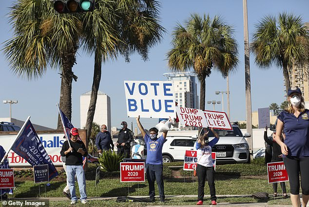 Houston, Texas: Supporters of Democratic presidential nominee Joe Biden and U.S. President Donald Trump rally along West Gray Street