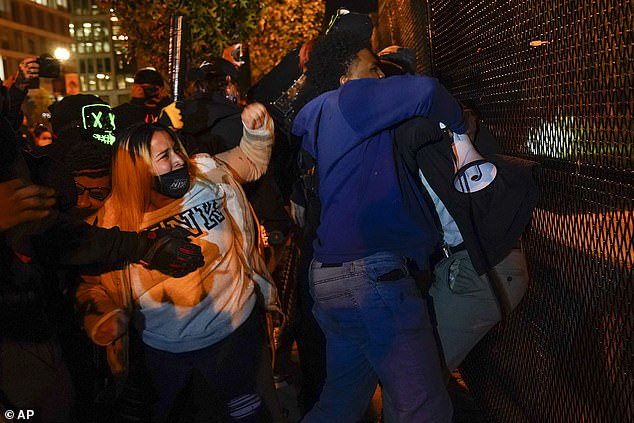 Washington DC: Black Lives Matter supporters, left, clash with Trump supporters, obscured