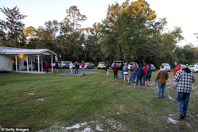 Crawfordville, Florida: Voters stand in line at dawn as the polls open on November 3
