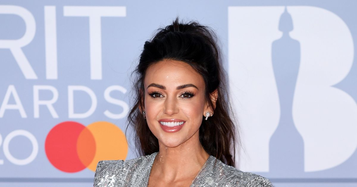 Michelle Keegan oozes class as she beams from ear-to-ear in 'very happy' snaps