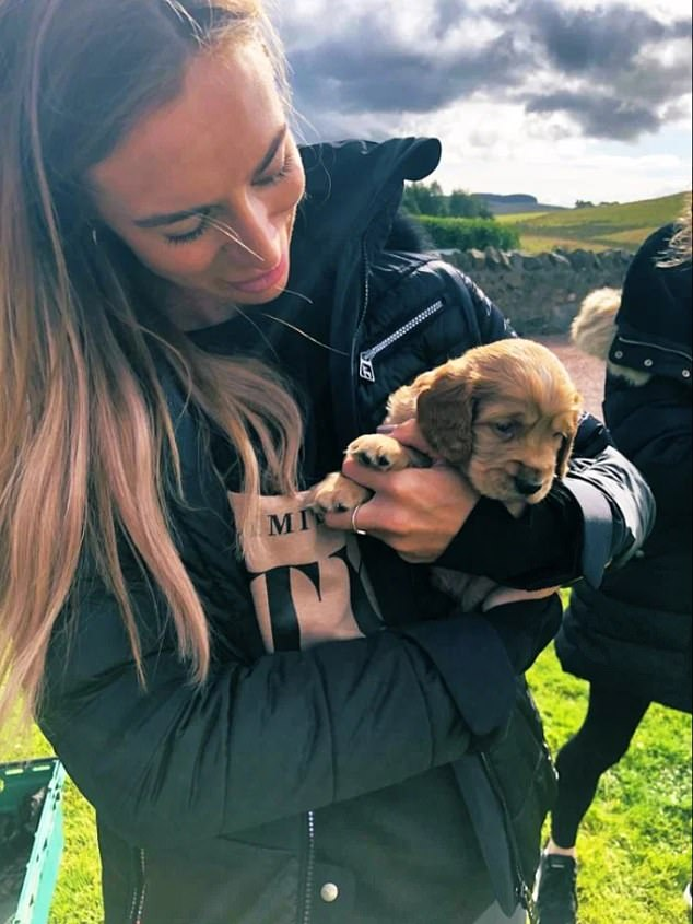 Ms Greville, 36, has reportedly moved out of the house in Cheshire with her golden retriever Mac (pictured together), and is now said to be in a 'safe house'