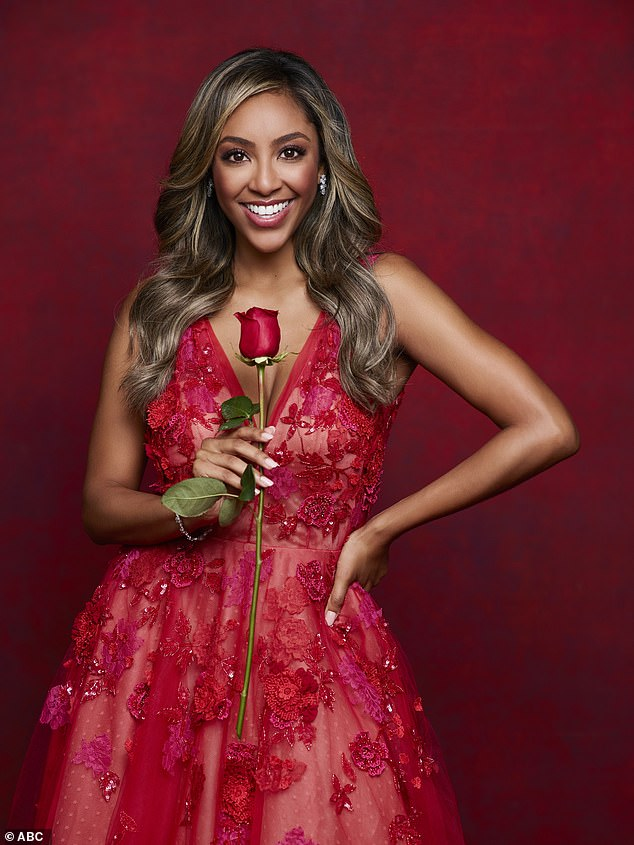Roses are red! Tayshia held onto a long rose as she posed in a blood red dress