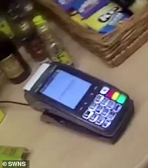 A card machine was left on the side near food