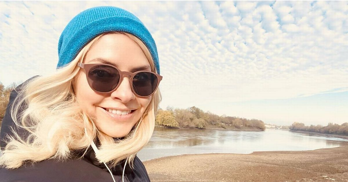 Holly Willoughby beams as she escapes lockdown for crisp autumn walk