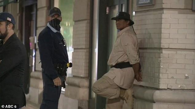 Lamotta is seen handcuffed on Thursday night in Philadelphia near the convention center