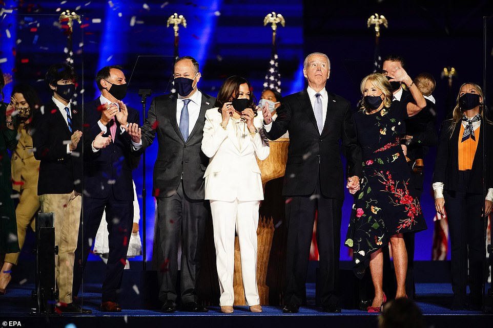 The new president-elect and vice president-elect were joined by their family members on the outdoor stage after they both addressed the nation, proclaiming their victory