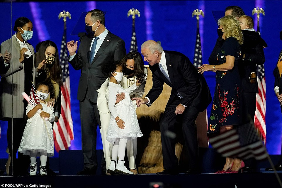 Biden bent down to talk to the young girl and later the president-elect held his youngest grandchild, Hunter's baby boy, while 'Simply the Best' played