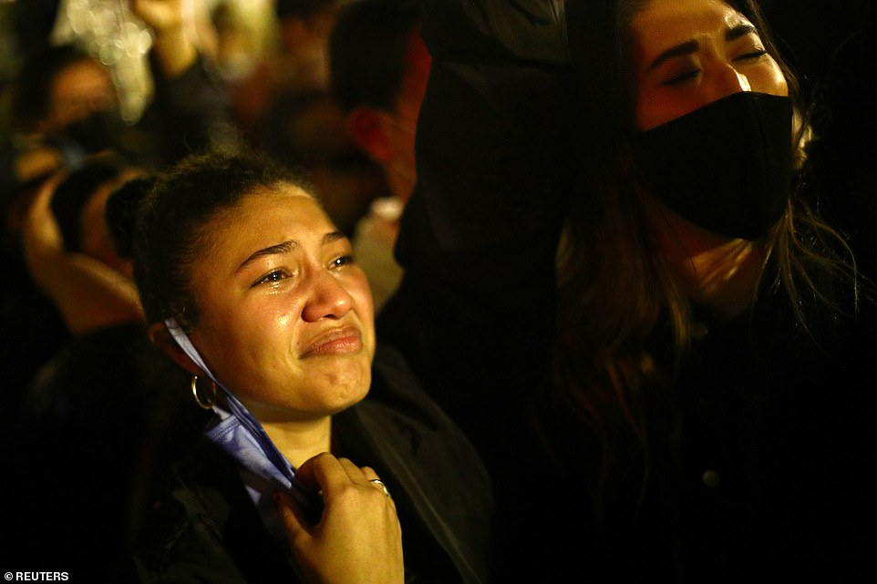 WASHINGTON, DC: A Biden supporter becomes emotional as she watched the president-elect's speech from BLM Plaza in the nation's capital on Saturday