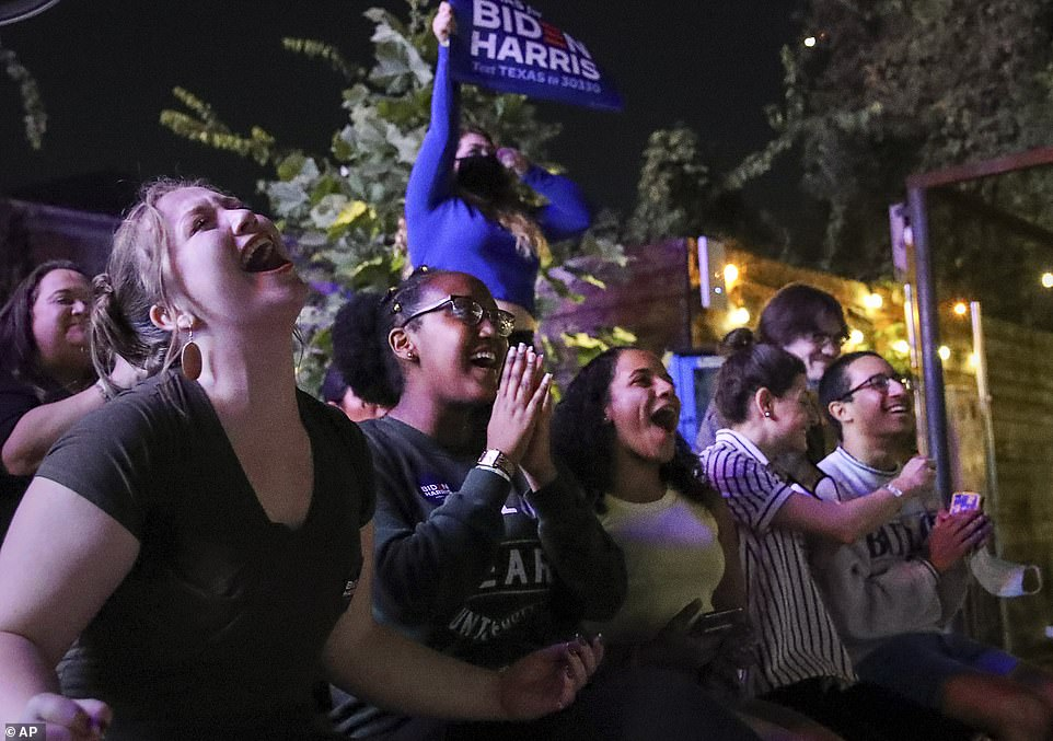 HOUSTON:Supporters of President-elect Joe Biden and Vice President-elect Kamala Harris cheer as they watch the broadcast of their speech at a watch party in Houston, Texas