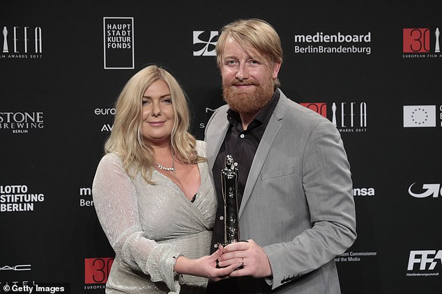Welchman is pictured with his wife Dorota Kobiela in Berlin in December 2017