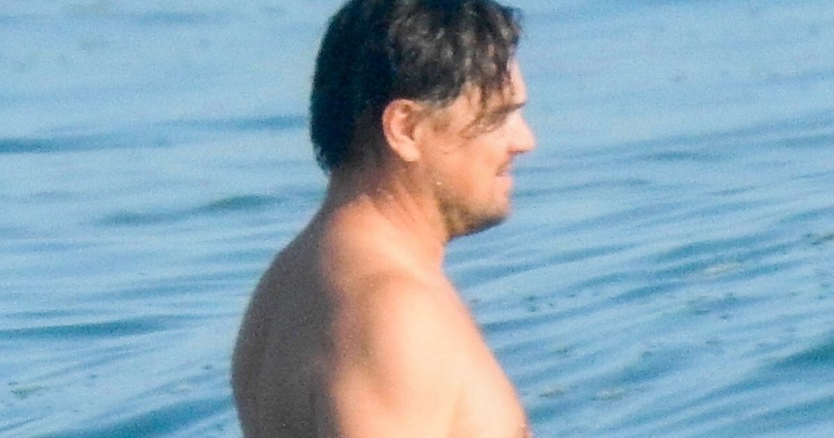 Shirtless Leonardo DiCaprio shows off 'dad bod' as he hits the beach with pals