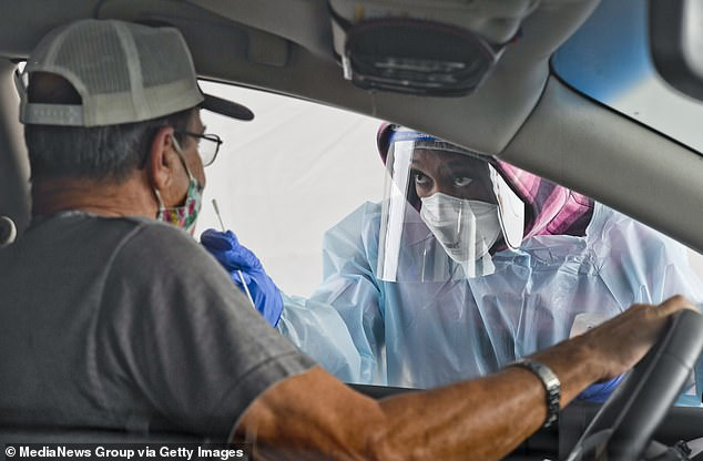 A man gets swabbed by CNA Keila Kelley at the state run free COVID-19 testing site setup on Front Street in Reading, Pennsylvania.The NBA will reportedly require anyone who will be within 30 feet of the court to test negative for COVID-19 two days before the game