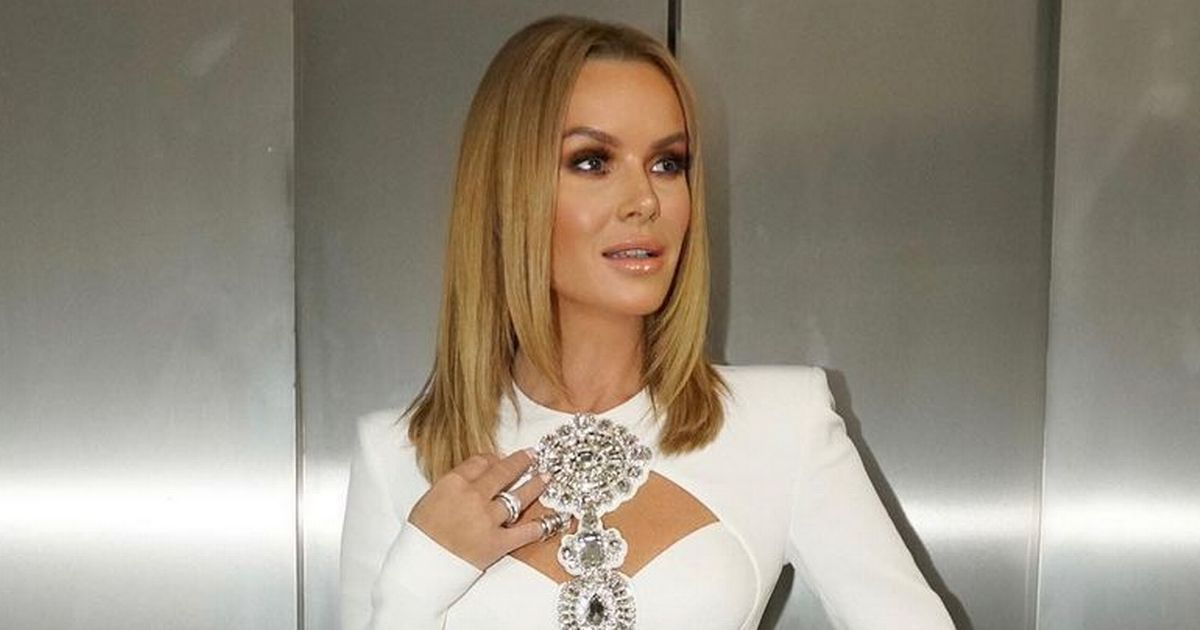 Amanda Holden dazzles in 'angelic display' after having put up Christmas tree