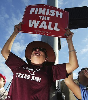 A Texas demonstrator shows support for a wall spanning the full length of the U.S.-Mexico border