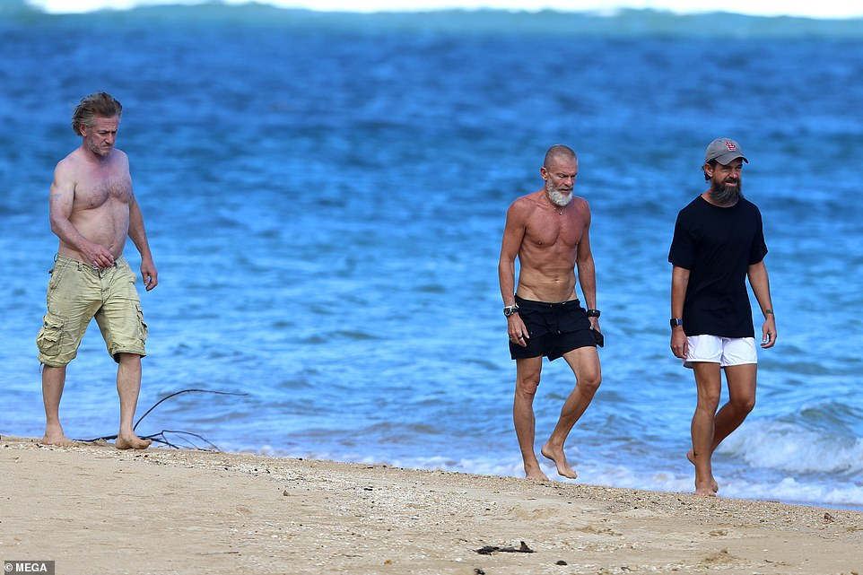 In pictures obtained exclusively by DailyMail.com all three men can be seen strolling along the sands in their shorts. Dorsey opted to keep his shirt on while Penn and Nevo went shirtless