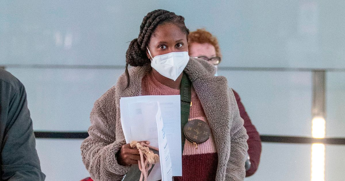 Motsi Mabuse clasped medical documents as she left for 'urgent' Germany trip