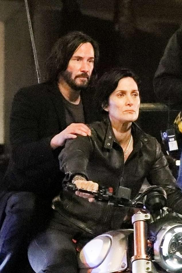 Attendees at The Matrix 4 celebration reportedly included Keanu Reeves and his girlfriend Alexandra Grant as well as the film's creators Lana and Lilly Wachowski. Pictured above, Keanu Reeves andCarrie-Anne Moss in The Matrix 4