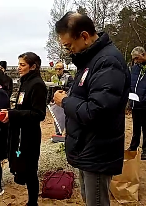 Anni's father Vinod (right) and mother Nilam were at the memorial near their home in Mariestad, Sweden, to place roses in a lake where her ashes were scattered. Vinod has called on Mr Dewani to give them answers about her death