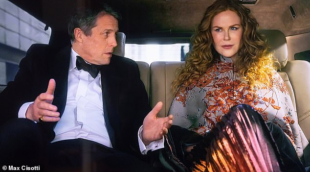 Caped-crusader with Italian flair: Just wow. This embroidered cape with a stand-up collar by Italian boho brand Etro should never, ever be removed. Back away, coat check lady! Pictured: Kidman with co-star Hugh Grant