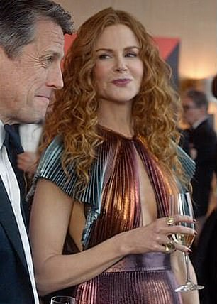 It's not a coat, but I kept rewinding episode one's charity fundraiser scene, just to see this £6,775 Givenchy dress, designed by Clare Waight Keller (she who gave us Meghan's wedding dress) before she left the brand. I call this Nicole's Quality Street look: it's the wrapper, she's the sweet