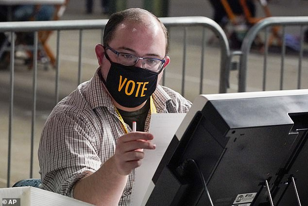 Poll workers in Pittsburgh, Pennsylvania, are seen counting votes on November 6